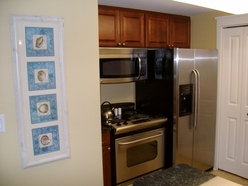 Waterscape kitchen areas with stainless steel appliance package